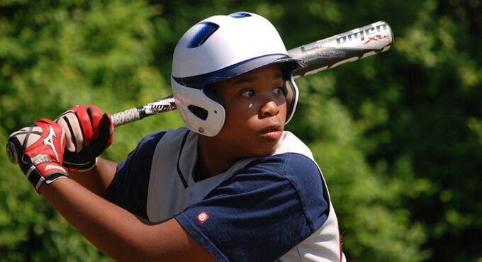 young baseball player with a bat